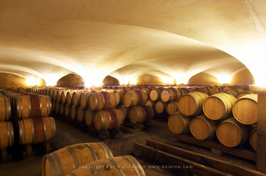 The old style vaulted barrel aging cellar with barriques pieces with maturing wine, Maison Louis Jadot, Beaune Côte Cote d Or Bourgogne Burgundy Burgundian France French Europe European