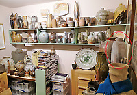 BNPS.co.uk (01202 558833)<br /> Pic: AdamPartridgeAuctioneers/BNPS<br /> <br /> Pictured: The so-called 'Pot Room' at the house in Digswell from where the collection rapidly spread. This room includes a large white bottle with pink decoration by Dorte Visby. <br /> <br /> A huge collection of pottery and ceramics found stacked inside the suburban home of an elderly couple has sold for almost £200,000.<br /> <br /> Leonard and Alison Shurz filled every room of their three bed house with ceramic pieces they had gathered from all over the world.<br /> <br /> The Aladdin's Cave of pots, bowls, plates, vases and jugs was found by a stunned auctioneer who had the daunting task of cataloguing it all.