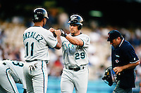 Bruce Aven of the Florida Marlins is greeted by teammate Alex Gonzalez during a game against the Los Angeles Dodgers at Dodger Stadium circa 1999 in Los Angeles, California. (Larry Goren/Four Seam Images)
