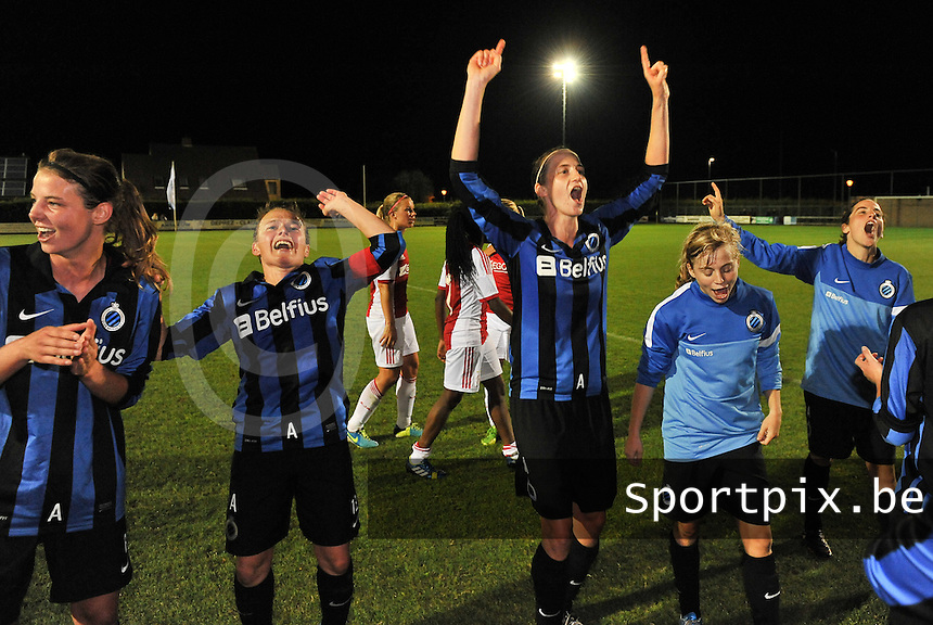 20130830 - VARSENARE , BELGIUM : Brugge's Heleen Jaques (middle) , Brugge's Christine Saelens (left) , Brugge's Yana Haesebroek (2r) and Brugge's Lore Dezeure pictured celebrating the draw as a victory over Ajax during the female soccer match between Club Brugge Vrouwen and Ajax Amsterdam Dames , of the first matchday in the BENELEAGUE competition. Friday 30 August 2013. PHOTO DAVID CATRY