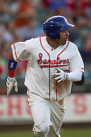 Wearing an Austin Senators throwback uniform, Round Rock Express designated hitter Manny Ramirez (39) jogs to first base after smashing a 2 run home run in the third inning of the Pacific Coast League baseball game against the Oklahoma City RedHawks on July 9, 2013 at the Dell Diamond in Round Rock, Texas. Round Rock defeated Oklahoma City 11-8. (Andrew Woolley/Four Seam Images)
