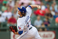 Round Rock Express pitcher Luke Jackson (27) delivers a pitch to the plate during the Pacific Coast League baseball game against the Oklahoma City RedHawks on August 1, 2014 at the Dell Diamond in Round Rock, Texas. The Express defeated the RedHawks 6-5. (Andrew Woolley/Four Seam Images)
