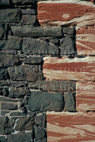 Stone wall with granite and Jacobsville sandstone in Hancock Michigan.