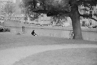 people resting in a park of Amsterdam
