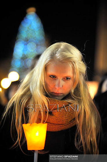 Girl,members of the ecumenical christian community of Taize pray with Pope Benedict XVI the prayer with the ecumenical christian community of Taize in St.Peter's square at the Vatican. December 29, 2012..