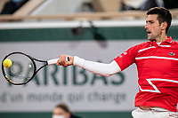 N11th October 2020, Roland Garros, Paris, France; French Open tennis, mens singles final 2020; Novak DJOKOVIC of Serbia hits a return against Rafael NADAL of Spain in the mens final match during the French Open tennis tournament at Roland Garros