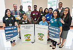 Robert Gasparello poses for a photograph with Sharpstown High School students and staff after a Children at Risk awards presentation to area schools at Pilgrim Academy, June 6, 2016.