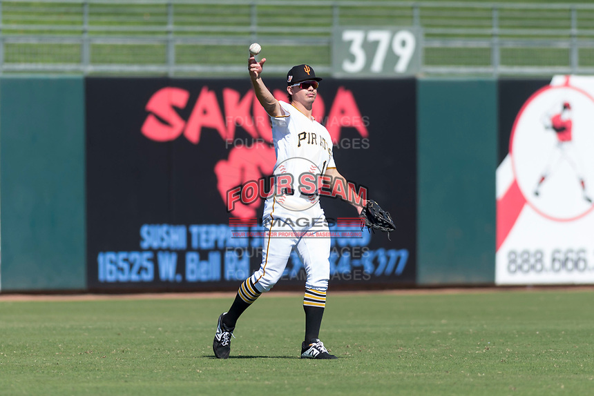 Surprise Saguaros left fielder Bryan Reynolds (10), of the Pittsburgh Pirates organization, throws to the infield during an Arizona Fall League game against the Peoria Javelinas at Surprise Stadium on October 17, 2018 in Surprise, Arizona. (Zachary Lucy/Four Seam Images)