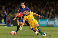 June 7, 2016: LAZAROS CHRISTODOULOPOULOS (10) of Greece and MILOS DEGENEK (6) of Australia compete for the ball during an international friendly match between the Australian Socceroos and Greece at Etihad Stadium, Melbourne. Photo Sydney Low