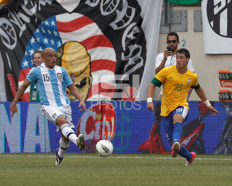 Brazil substitute midfielder Giuliano (18) passes the ball as Argentina defender Clemente Rodriguez (15) defends. In an international friendly (Clash of Titans), Argentina defeated Brazil, 4-3, at MetLife Stadium on June 9, 2012.
