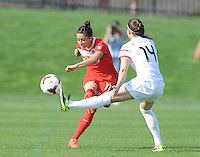 Boyds MD - April 13, 2014: Ali Krieger (11) of the Washington Spirit goes against Vicky Losada (14) of the Western New York Flash. The Western New York Flash defeated the Washington Spirit 3-1 in the opening game of the 2014 season of the National Women's Soccer League at the Maryland SoccerPlex.