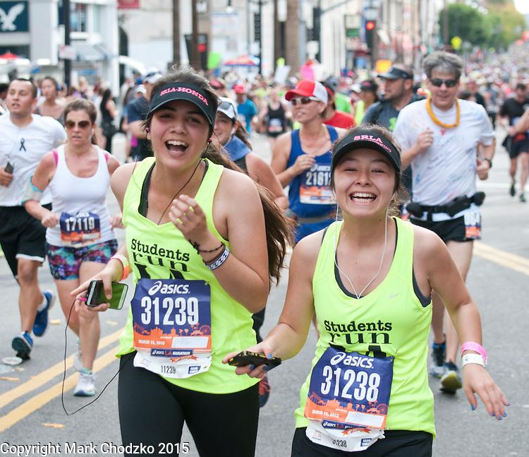 Friends laugh it up at the L.A. Marathon.
