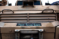 The front bull-bar of a MRAP with a message to any padestrians. Later that day an MRAP in the patrol hit a young boy and killed him