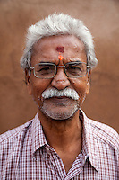 Agra, India.  Man from Maharashtra State.   He has a bindi between his eyebrows, representing the third eye or spiritual sight that Hindus seek.  It is also said to protect against demons or bad luck.