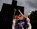 Michael Beasley (30) drives to the basket between Kevin Love (42) and another defender during the Elite 24 Hoops Classic game on September 1, 2006 held at Rucker Park in New York, New York.  The game brought together the top 24 high school basketball players in the country regardless of class or sneaker affiliation.