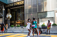 """NEW YORK, NY - JULY 9: Two women pose next to the """"Black Lives Matter"""" mural in front of the Trump Tower in New York, NY on July 9, 2020. Bill de Blasio, Mayor of New York and founders of the National Action Network Inc. (NAN) paints a """"Black Lives Matter"""" mural along Fifth Avenue across from the Trump Tower in New York. President Donald Trump criticized the mayor's plan to paint a street mural in front of Trump Tower. (Photo by Pablo Monsalve / VIEWpress via Getty Images)"""