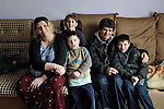 Giltena Duda and her husband Ismet Sabanaj, here with three of their six children, live in the Zemun Polje Roma neighborhood of Belgrade, Serbia. Ms. Duda is pregnant with her seventh child. They are Roma refugees from Kosovo, and thus legally marginalized in Serbia. They built their home on unregistered land and pirate their electrical hookup. Without legal residency, their children can't attend a regular school, and they have difficulties getting formal employment. Yet both participate in an adult literacy program sponsored by the Branko Pesic School, where their children attend classes. The school is supported by Church World Service.