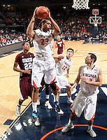 CHARLOTTESVILLE, VA- December 27: Mike Scott #23 of the Virginia Cavaliers grabs a rebound next to Ron Spencer #22 of the Maryland-Eastern Shore Hawks during the game on December 27, 2011 at the John Paul Jones Arena in Charlottesville, Va. Virginia defeated Maryland Eastern Shore 69-42.  (Photo by Andrew Shurtleff/Getty Images) *** Local Caption *** Ron Spencer;Mike Scott
