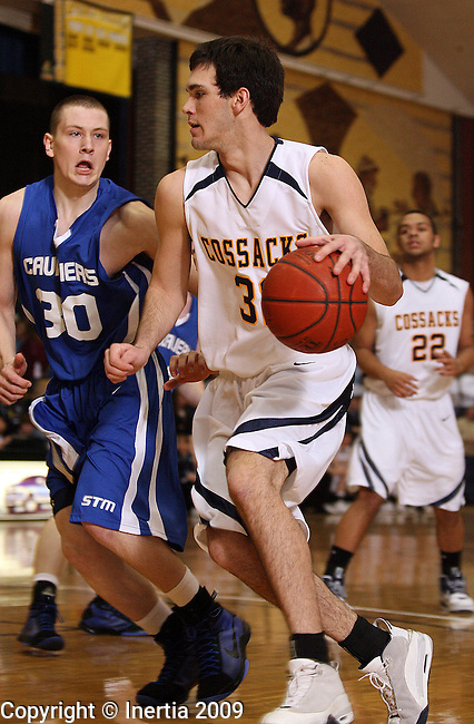 MITCHELL, SD - JANUARY 24:  Nathan Kramer #32 of Sioux Valley looks to get past the defense of Brandon Bassett #30 of St. Thomas More in the first half of their game at the Hanson Classic Saturday evening in Mitchell. (Photo by Dave Eggen/Inertia)