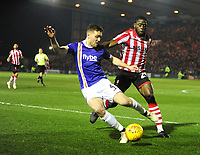 Lincoln City's John Akinde battles with  Exeter City's Dara O'Shea<br /> <br /> Photographer Andrew Vaughan/CameraSport<br /> <br /> The EFL Sky Bet League Two - Lincoln City v Exeter City - Tuesday 26th February 2019 - Sincil Bank - Lincoln<br /> <br /> World Copyright © 2019 CameraSport. All rights reserved. 43 Linden Ave. Countesthorpe. Leicester. England. LE8 5PG - Tel: +44 (0) 116 277 4147 - admin@camerasport.com - www.camerasport.com