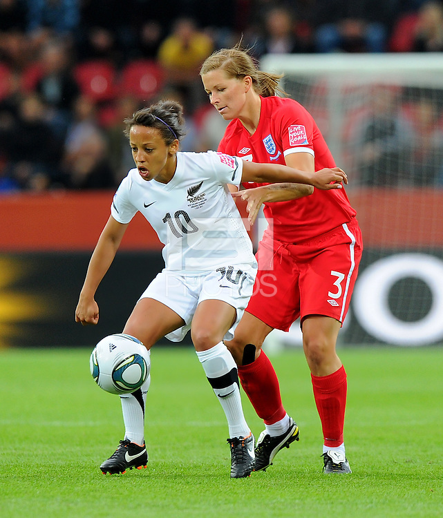 Sarah Gregorius (l) of Team New Zealand and Rachel Unitt of team England during the FIFA Women's World Cup at the FIFA Stadium in Dresden, Germany on July 1st, 2011.