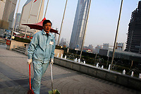 CHINA. Shanghai. A street cleaner. Shanghai is a sprawling metropolis or 15 million people situated in south-east China. It is regarded as the country's showcase in development and modernity in modern China. This rapid development and modernization, never seen before on such a scale has however spawned countless environmental and social problems. 2008