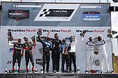 #10: Konica Minolta Acura ARX-05 Acura DPi, DPi: Ricky Taylor, Filipe Albuquerque,  celebrate the win in victory lane on the podium with #31: Whelen Engineering Racing Cadillac DPi, DPi: Felipe Nasr, Pipo Derani, #55: Mazda Motorsports Mazda DPi, DPi: Harry Tincknell, Oliver Jarvis