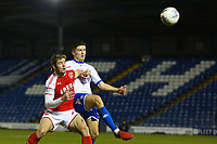 Fleetwood Town's Jack Sowerby (left) battles with Bury's Callum Reilly (right) during the The Checkatrade Trophy match between Bury and Fleetwood Town at Gigg Lane, Bury, England on 9 January 2018. Photo by Juel Miah/PRiME Media Images.