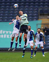 3rd October 2020; Ewood Park, Blackburn, Lancashire, England; English Football League Championship Football, Blackburn Rovers versus Cardiff City; John Buckley of Blackburn Rovers and Isaac Vassell of Cardiff City compete for the ball in the air