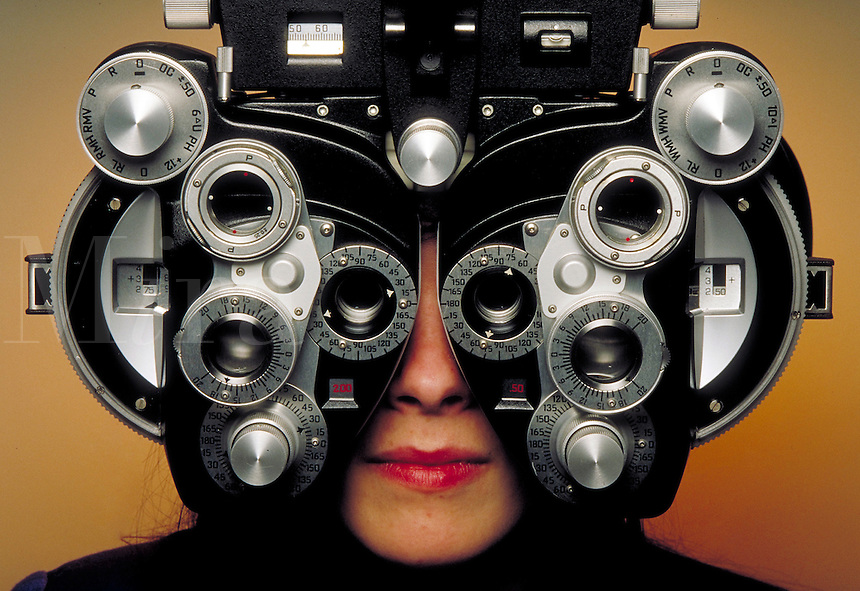 Female patient getting eye exam.