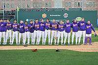 Members of the Clemson Tigers line up to sing the school alma mater following the Reedy River Rivalry game against the South Carolina Gamecocks on Saturday, March 3, 2018, at Fluor Field at the West End in Greenville, South Carolina. Clemson won, 5-1. (Tom Priddy/Four Seam Images)
