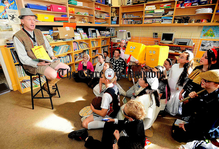 School Principal Kevin Glynn reads for his 5th and 6th classes during bookweek at Lahinch National school.Pic Arthur Ellis