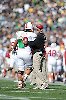 South Bend, IN - OCTOBER 4:  Center Alex Fletcher #60 and head coach Jim Harbaugh of the Stanford Cardinal during Stanford's 28-21 loss against the Notre Dame Fighting Irish on October 4, 2008 at Notre Dame Stadium in South Bend, Indiana.