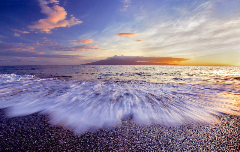 Sunset on Maui, Hawaii beach with Molokai in background.