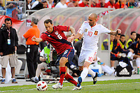 Steve Cherundolo (6) of the United States and Borja Valero (10)of Spain battle for the ball. The men's national team of Spain (ESP) defeated the United States (USA) 4-0 during a International friendly at Gillette Stadium in Foxborough, MA, on June 04, 2011.