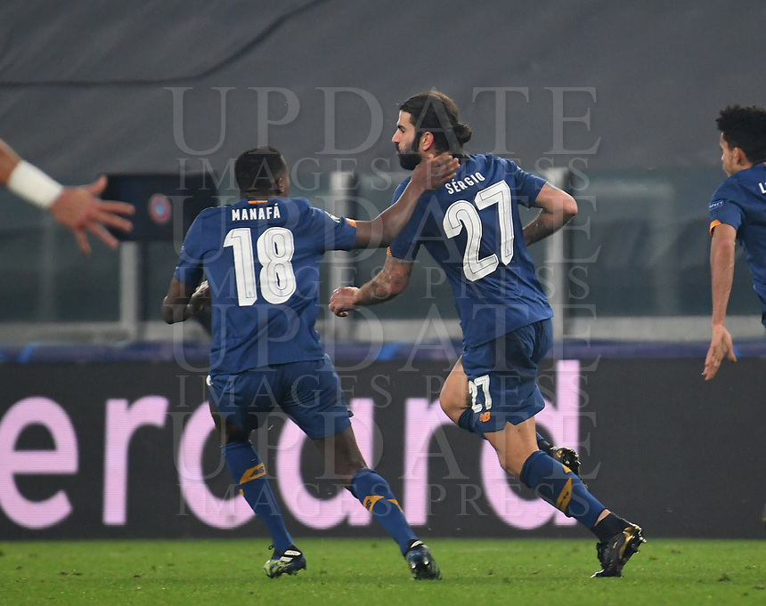 Football Soccer: UEFA Champions League -Round of 16 2nd leg Juventus vs FC Porto, Allianz Stadium. Turin, Italy, March 9, 2021.<br /> Porto's Sergio Oliveira (C) celebrates  with his teammates  after scoring his second goal in the match during the Uefa Champions League football soccer match between Juventus and Porto at Allianz Stadium in Turin, on March 9, 2021.<br /> UPDATE IMAGES PRESS/Isabella Bonotto