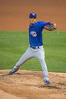Armando Rivero (32) of the Iowa Cubs delivers a pitch to the plate against the Salt Lake Bees in Pacific Coast League action at Smith's Ballpark on August 21, 2015 in Salt Lake City, Utah. The Bees defeated the Cubs 12-8.  (Stephen Smith/Four Seam Images)