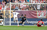Clint Dempsey (8) of the USMNT scores a goal underneath Volkan Demirel (1) of Turkey at Lincoln Financial Field in Philadelphia, PA.  The USMNT defeated Turkey, 2-1.