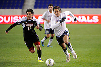 Tony Cascio (14) of the Connecticut Huskies is defended by Michael Roman (17) of the Louisville Cardinals. Connecticut defeated Louisville 1-0 during the first semifinal match of the Big East Men's Soccer Championships at Red Bull Arena in Harrison, NJ, on November 11, 2011.
