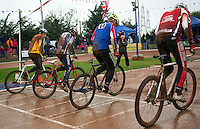 31 AUG 2015 - IPSWICH, GBR - Riders push from the start of a heat during the British Cycle Speedway Championships at Whitton Sports and Community Centre in Ipswich, Suffolk, Great Britain (PHOTO COPYRIGHT © 2015 NIGEL FARROW, ALL RIGHTS RESERVED)