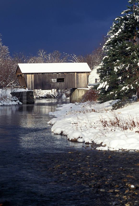 AJ4624, covered bridge, winter, Vermont, Warren Covered Bridge c.1880 crosses over the Mad River in Warren in Mad River Valley in Washington County in the state of Vermont.