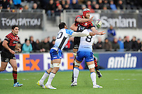 Alistair Hargreaves of Saracens uses his height to offload as he is tackled by George Naoupu (left) and John Muldoon of Connacht Rugby as  during the Heineken Cup Round 6 match between Saracens and Connacht Rugby at Allianz Park on Saturday 18th January 2014 (Photo by Rob Munro)