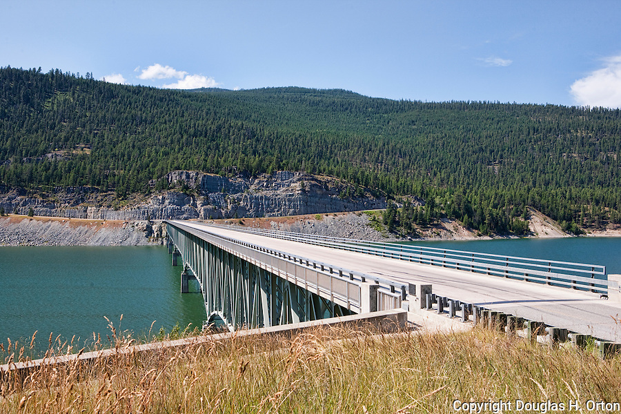 """Koocanusa Bridge, the longest and highest in Montana.  Scenic Lake Koocanusa lies north of Libby, Montana and is formed by Libby Dam, blocking the Kootenai River and forming a resevoir nearly four hundred feet deep and fourty-eight miles long.  Scenic drives encircle the lake crossing over at the """"long bridge"""", Montana's longest span."""
