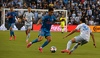 KANSAS CITY, KS - MAY 29: Memo Rodriguez #8 of Houston Dynamo FC attempts to get past Luis Martins #36 of Sporting KC during a game between Houston Dynamo and Sporting Kansas City at Children's Mercy Park on May 29, 2021 in Kansas City, Kansas.