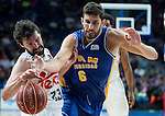 Real Madrid's Sergio Llull and UCAM Murcia's Jose Angel Antelo during the first match of the playoff at Barclaycard Center in Madrid. May 27, 2016. (ALTERPHOTOS/BorjaB.Hojas)