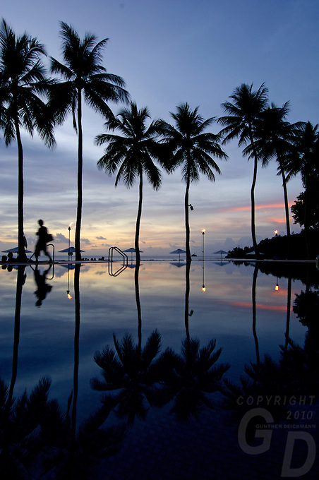REFLECTION OF A RESORT POOL IN PALAU, MICRONESIA