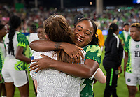 AUSTIN, TX - JUNE 16: Rose Lavelle #16 of the USWNT hugs Francisca Ordega #17 of Nigeria during a game between Nigeria and USWNT at Q2 Stadium on June 16, 2021 in Austin, Texas.