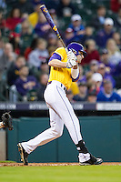 LSU Tigers outfielder Mark Laird (9) follows through on his swing during the Houston College Classic against the Nebraska Cornhuskers on March 8, 2015 at Minute Maid Park in Houston, Texas. LSU defeated Nebraska 4-2. (Andrew Woolley/Four Seam Images)