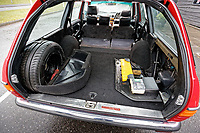 The spare wheel and first aid kit in the boot of the Mercedes W123 series 230TE estate version, outside the Penderyn Whisky Distillery in south Wales, UK. Tuesday 19 June 2018