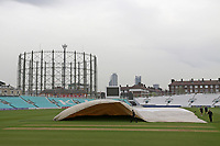 General view as the covers are removed from the square ahead of Surrey vs Essex Eagles, Royal London One-Day Cup Cricket at the Kia Oval on 23rd April 2019